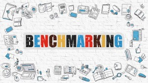 Benchmarking - Multicolor Concept with Doodle Icons Around on White Brick Wall Background. Modern Illustration with Elements of Doodle Design Style.